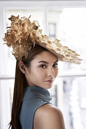 Golden Fascinator hat Couture lace